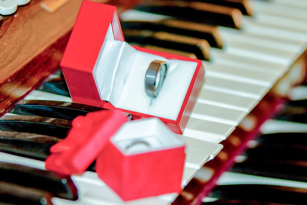 two wedding bands on piano keys