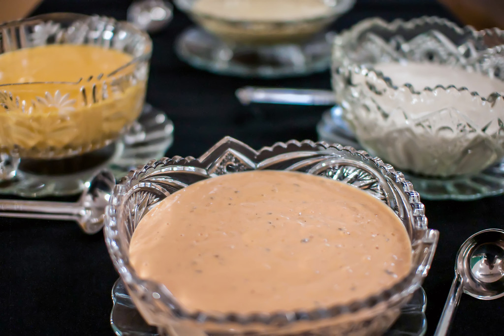 various salad dressings in crystal bowls