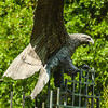 golden eagle in flight statue