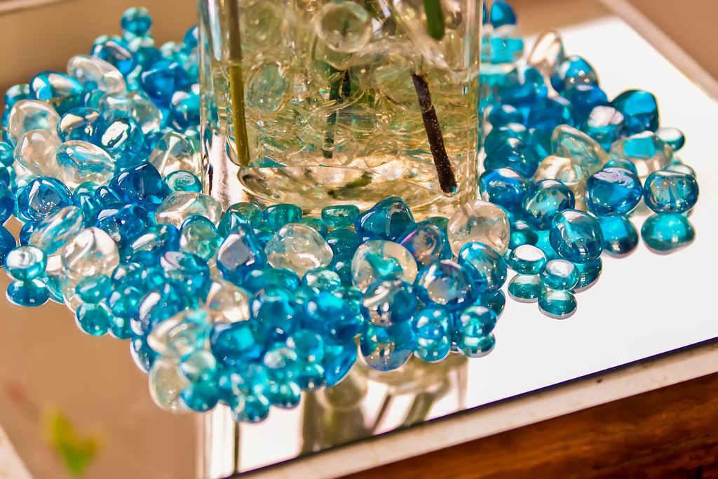 blue marbles on a reflective surface