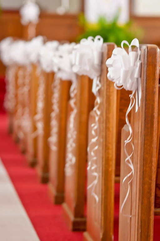 church isles decorated for wedding event