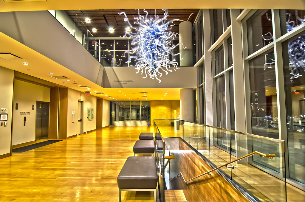 building interior with glass art piece suspended