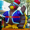 infalable thanksgiving turkey waving to crowd at a thanksgiving parade