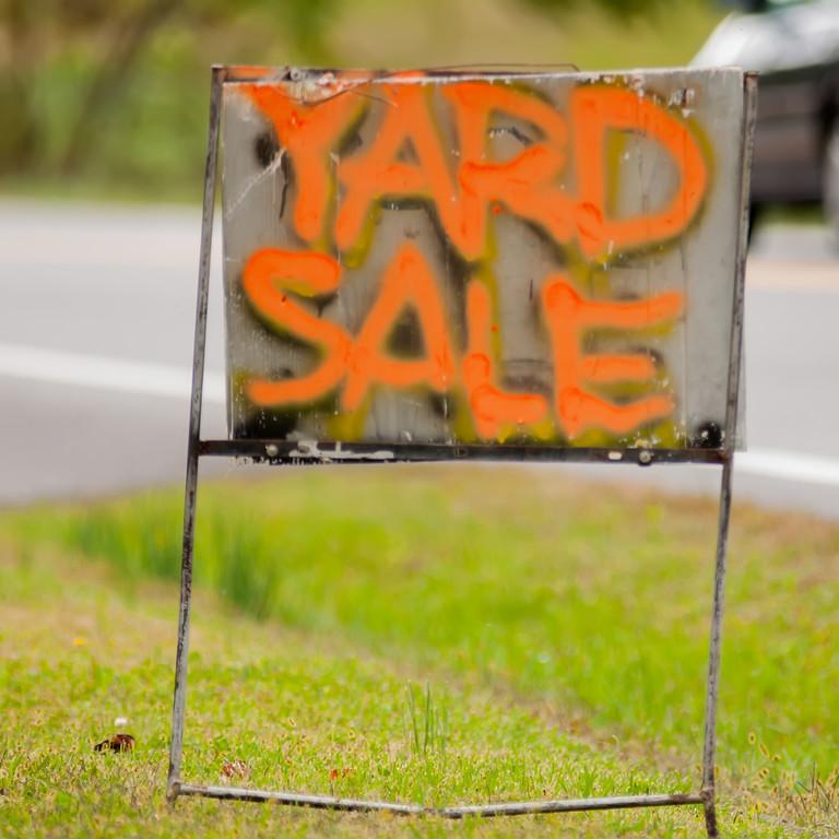orange handwriting yard sale sign