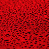 red water drops on water-repellent surface
