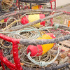 Fisherman, their gear , and their boats anxiously await the start of the 2007 Dungeness crab season.  Crab pots are stacked, awaiting the official start, and for the fishermen and buyers to agree on a price.  Past seasons have been delayed several weeks from the mid-November start.