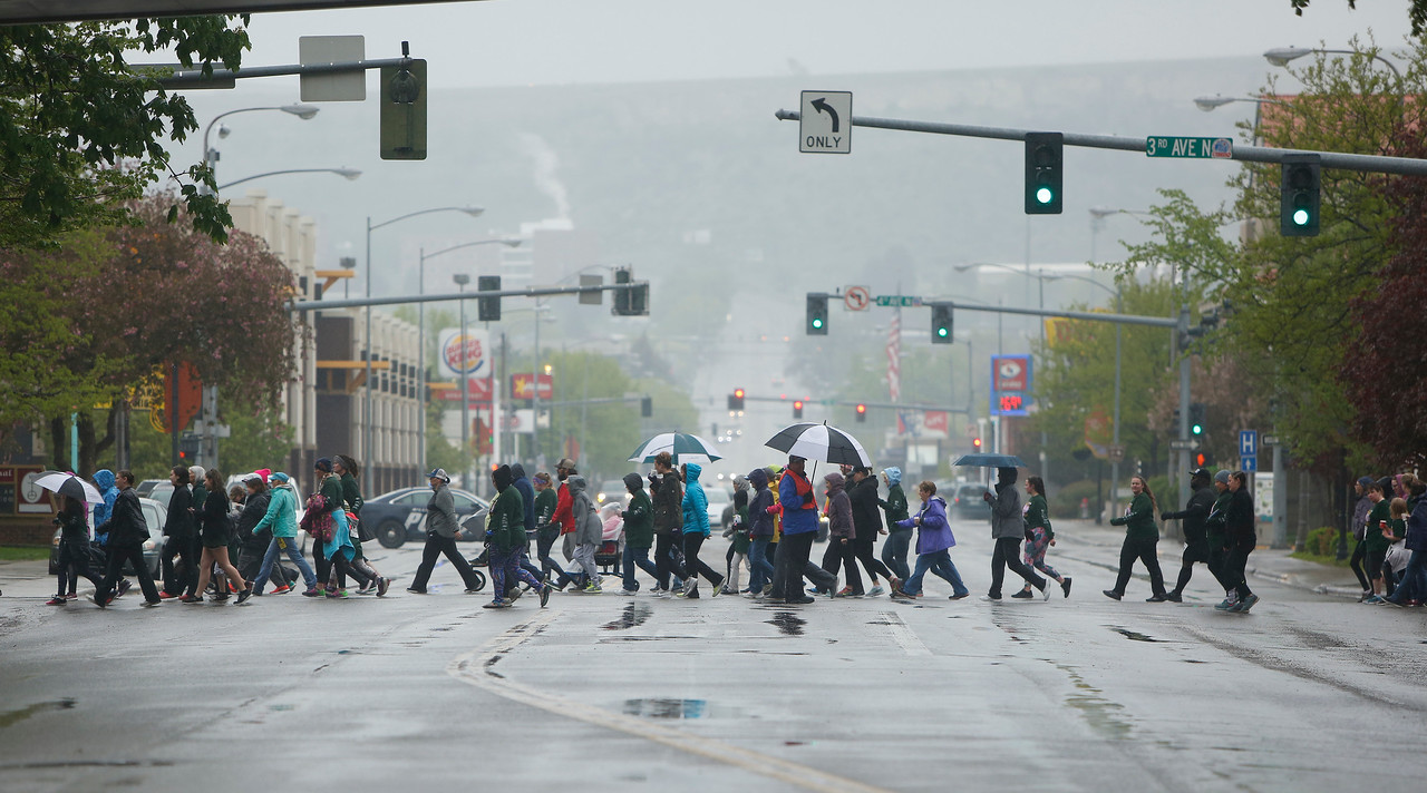 Participants cross 27th Street during the annual Montana Women's Run in Billings on May 12, 2018.