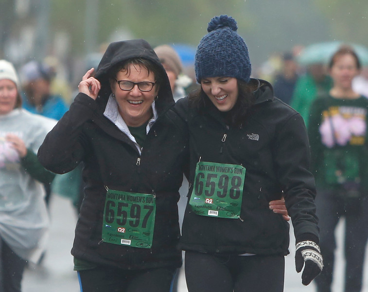 Lori Heimbichner, left, and Maggie Heimbichner, of Billings, walk towards the finish line in the five mile race during the annual Montana Women's Run in Billings on May 12, 2018.