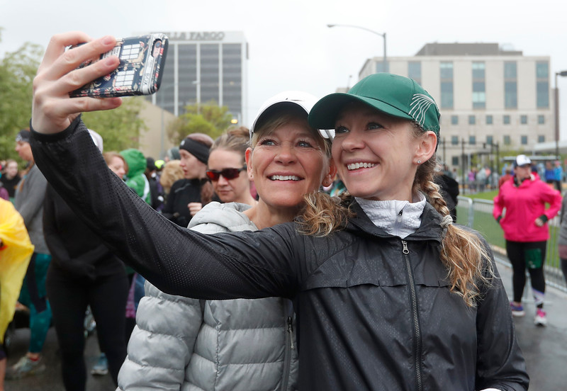 Kristen Yeley, right, of Billings, takes a selfie with her mom Carrie Mantooth, of Denton, before the start of the five mile race during the annual Montana Women's Run in Billings on May 12, 2018. This is the first time that Kristen, who typically runs, will walk with her mother in this race because she is currently nine weeks into her third pregnancy.