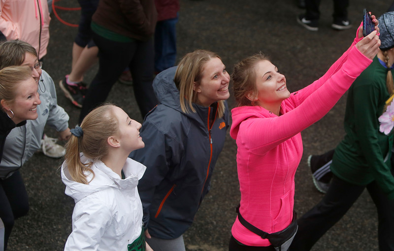 A group of participants take a selfie during the annual Montana Women's Run in Billings on May 12, 2018.