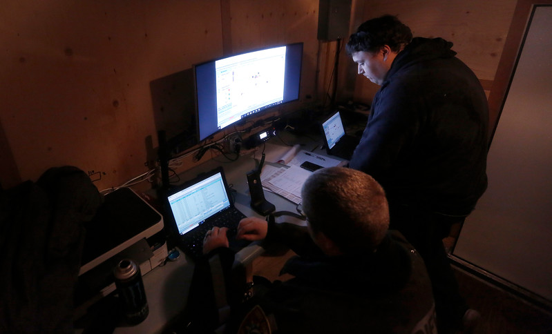 Coos County Sheriff's Office tactical dispatchers Andrew Otton, right, and Brian Kent work on the scene of an operation to gather intelligence on a known illegal marijuana grow on U.S. Forest Service land in southern Coos County on Wednesday, Nov. 15, 2017.