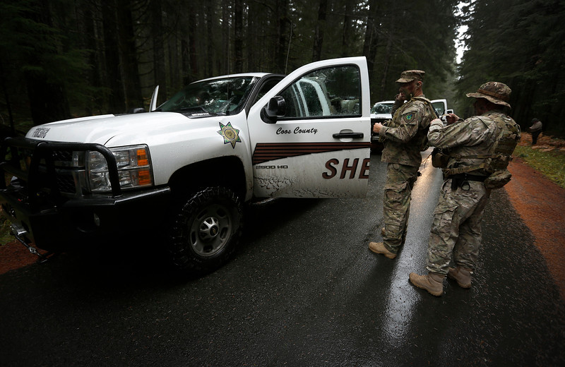 Members of law enforcement prepare for a Coos County Sheriff's Office operation to gather intelligence on a known illegal marijuana grow on U.S. Forest Service land in southern Coos County on Wednesday, Nov. 15, 2017.