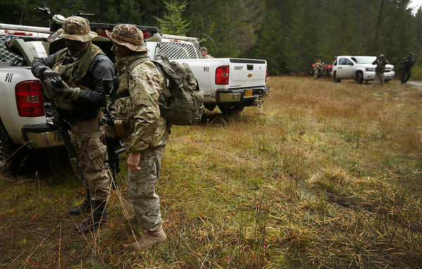 Members of law enforcement prepare to carry out a Coos County Sheriff's Office operation to gather intelligence on a known illegal marijuana grow on U.S. Forest Service land in southern Coos County on Wednesday, Nov. 15, 2017.