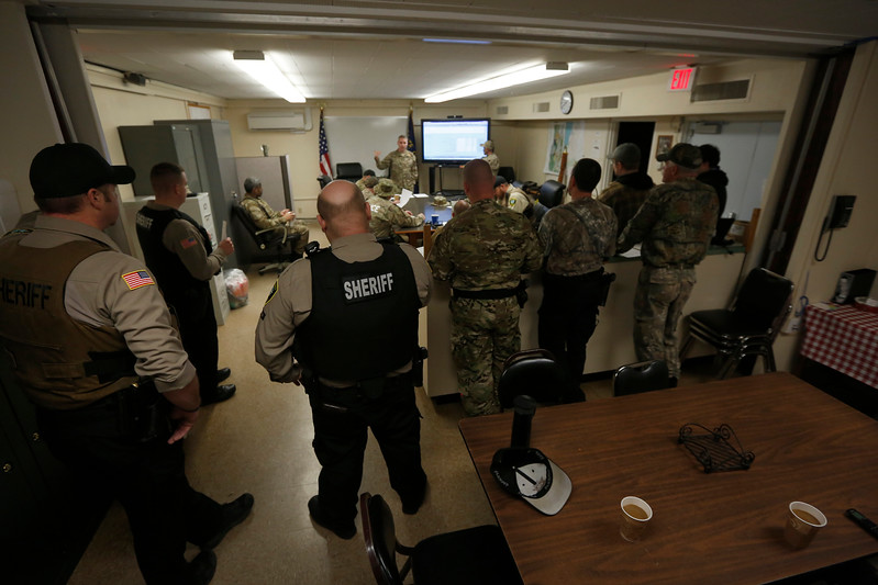 Members of law enforcement conduct a briefing at the Coos County Sheriff's Office prior an operation to gather intelligence on a known illegal marijuana grow on U.S. Forest Service land in southern Coos County on Wednesday, Nov. 15, 2017.