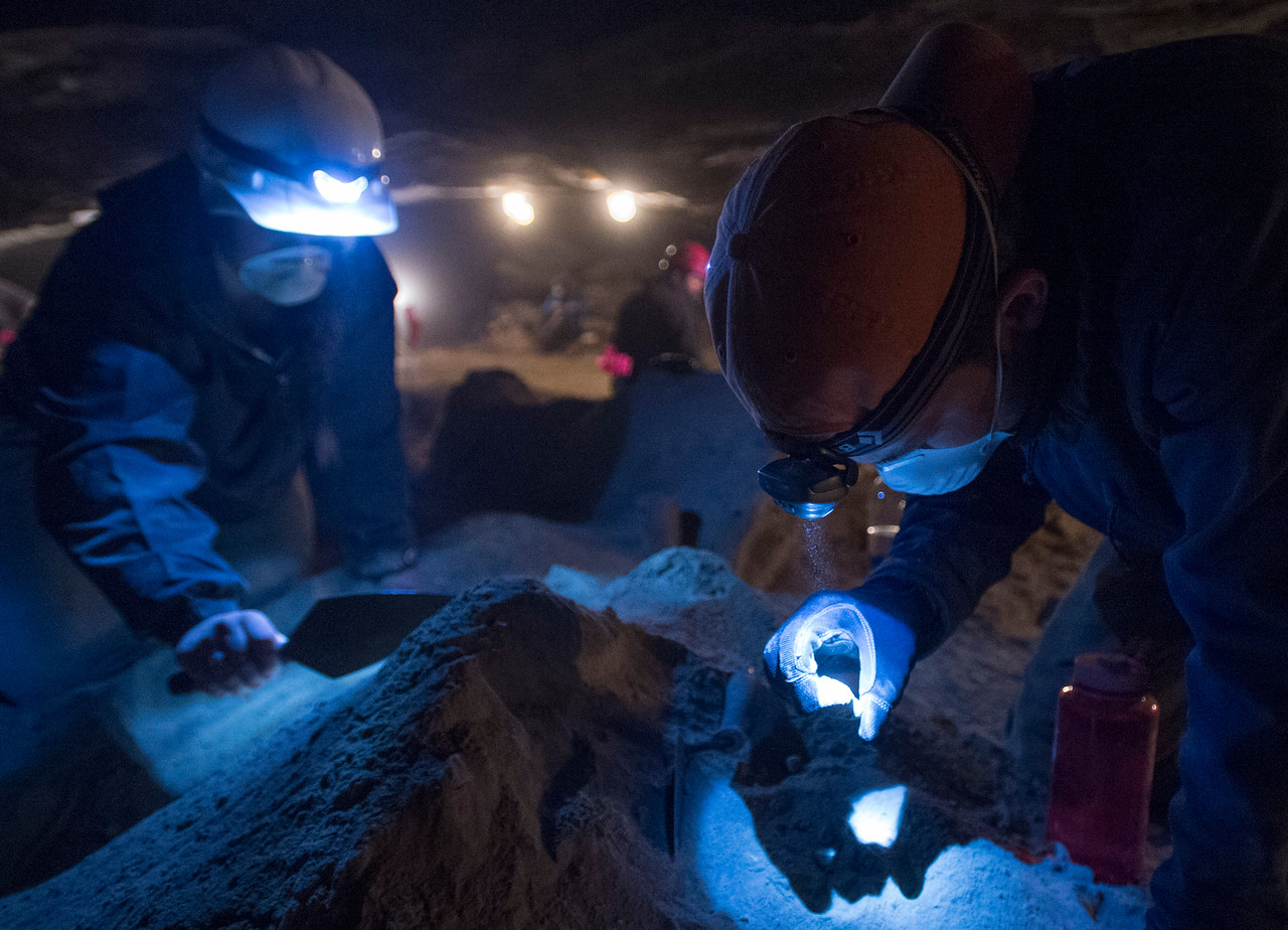 Criminology students from Idaho State University search for the human skull from a 36-year-old cold case in the Civil Defense caves north of Dubois near the Montana border on February 27, 2015.