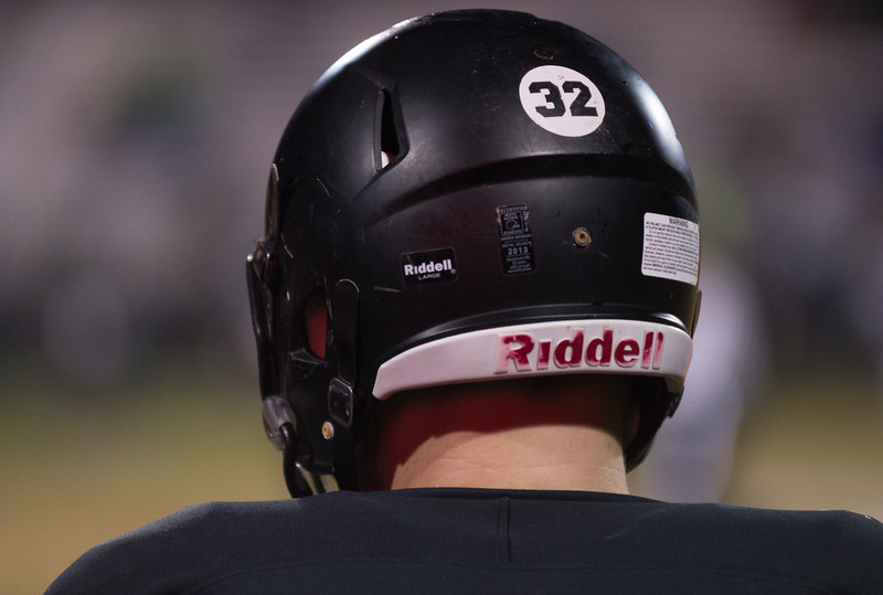 "Dylan Buell | dylanphotog@gmail.com | @dylanphotog<br /> Western Hills' Evan Hanus, along with the rest of the team, wore ""32"" stickers in honor of former teammate Garrett Hodapp who committed suicide during the season."