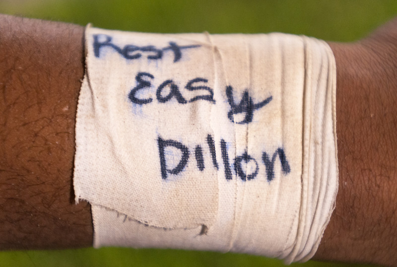 Dylan Buell | dylanphotog@gmail.com | @dylanphotog<br /> Western Hills senior Nick Lockett wears wrist tape with a memorial for Dillon Walker during the first football game of the season in Owenton, Kentucky, August 22, 2014.