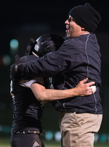 Dylan Buell | dylanphotog@gmail.com | @dylanphotog<br /> Western Hills head coach Don Miller celebrates with senior Bryan Litteral in the closing moments of the game against Shelby County that clinched a playoff berth for the Wolverines October 31, 2014.
