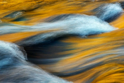 """FIRE WATER""Smoky MountainsReflected golden light of Autumn colors in late afternoon in this abstract composition along the Little River, Smoky Mountains.© Chris Moore - Exploring Light PhotographyPURCHASE A PRINT"