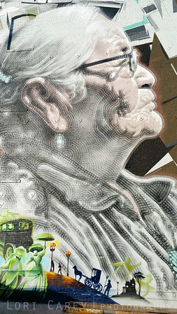 """Detail from Abuelita by El Mac & Kofie & Nuke. El Mac painted the portrait of the Navajo weaver. Joseph """"Nuke"""" Montalvo painted the lower left honoring the indigeous people, and Augustine Kofie painted pained the top portion with geometric and abstract shapres."""