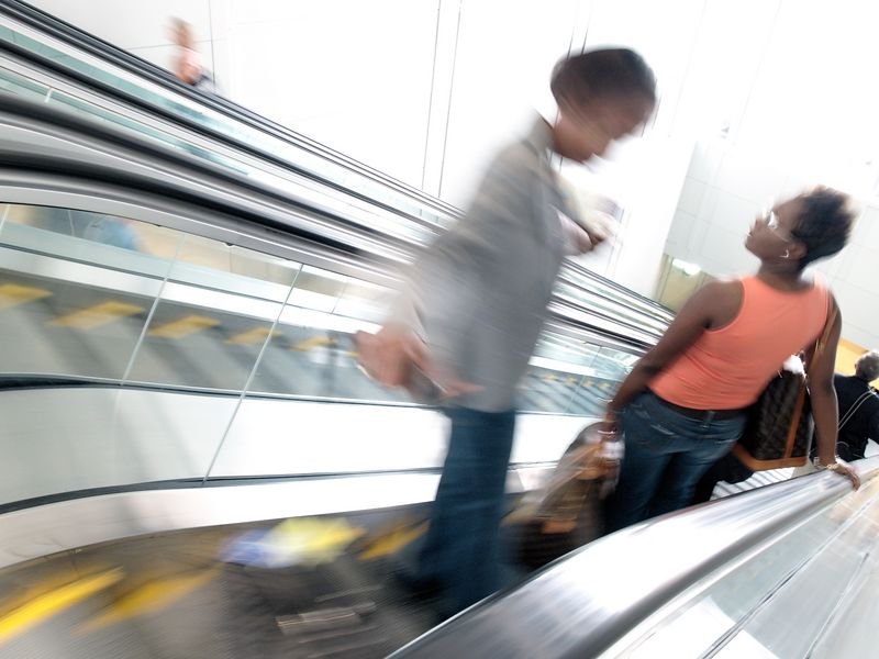 Airport patrons ride the escalators between the terminal gates and ground transportation at Dulles International Airport.