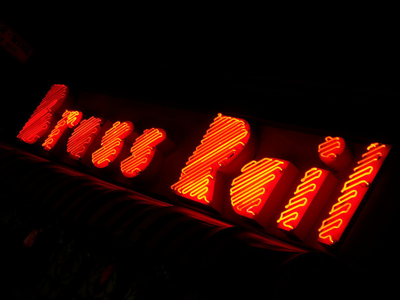 The neon sign outside of one of Port Huron's most famous landmarks - The Brass Rail.