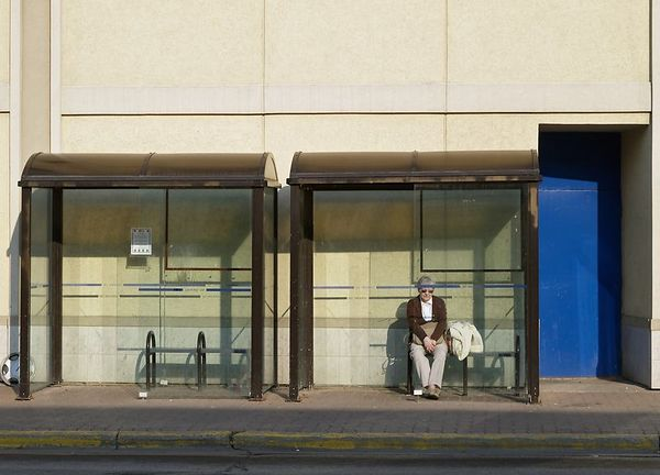 """<font size=3><div align =""""center"""">Nine Line</div>      Waiting for the #9 bus on Christina Street.  I'm still wondering about all of these blue doors...</font>"""