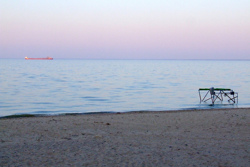 Lake freighter heads up Lake Huron as the sun sets.