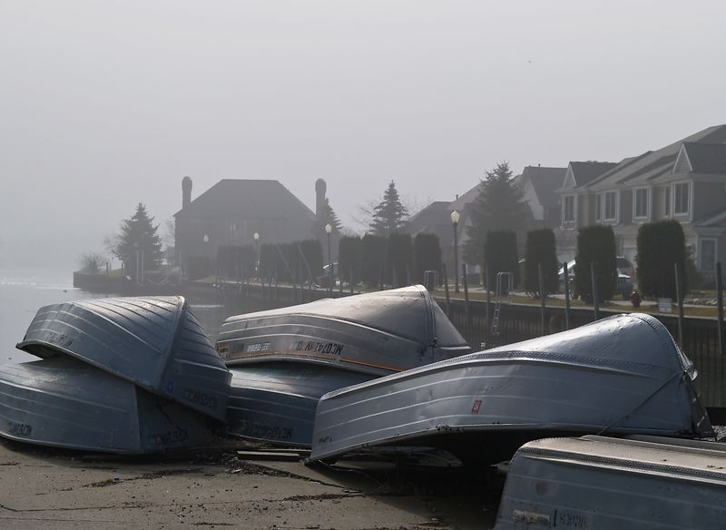 Rowboats laid out along the St. Clair River on a foggy morning.