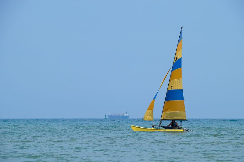 Sailboat out on Lake Huron of the Michigan shore