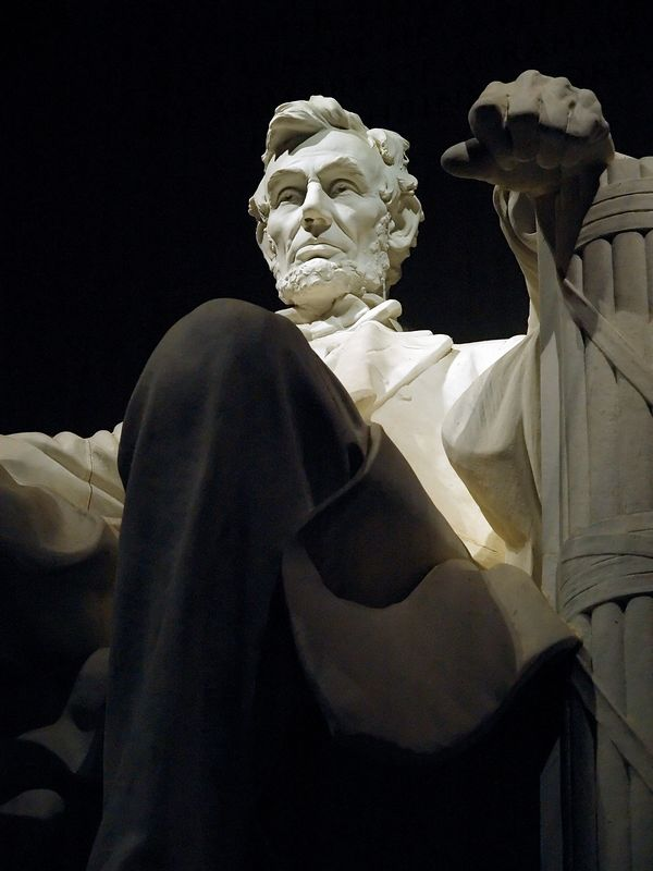 View of the statue of Abraham Lincoln in the Lincoln Memorial at night.  Washington, DC.