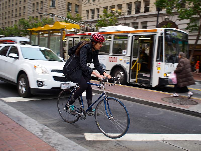 Bicycle Commuter, Market Street - San Francisco, California