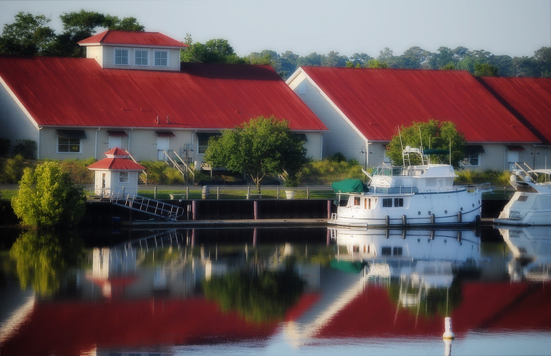 Some boats and buildings reflected in the water.  North Myrtle Beach, SC.