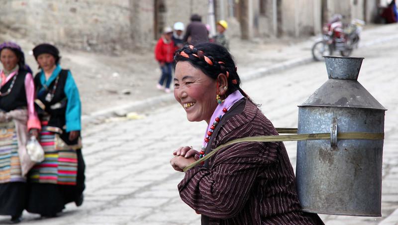 Woman with milk churn, Tibet