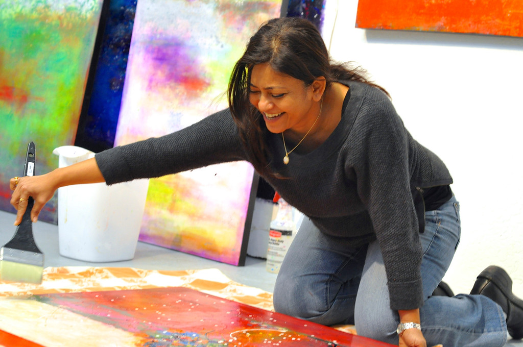 Student Jagruti, varnishing her beautiful painting.