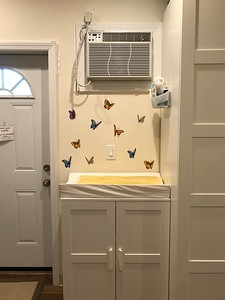 Changing table and AC for parents.