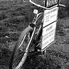 """Cruizer bike leaning against a """"Warning"""" sign at Lighthouse Point in Santa Cruz California - © Simpson Brothers Photography"""