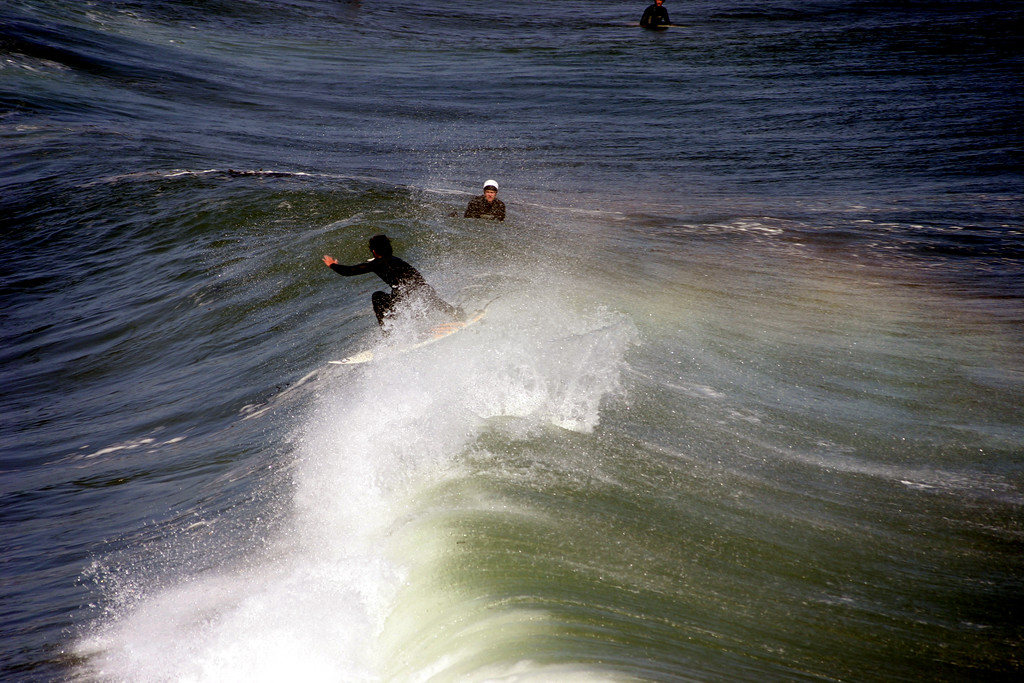 Surfing at Steamers Lane (Lighthouse Point) in Santa Cruz California - © Simpson Brothers Photography