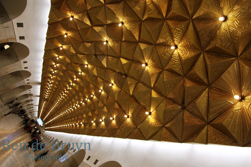 Aviamotornaya metro station Moscow Russia with anodized gold pyramids shaped objects as ceiling