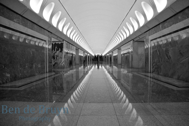 Dostoevsky metro station with reflections from marble tiles and scenes from Dostoevsky novels on walls