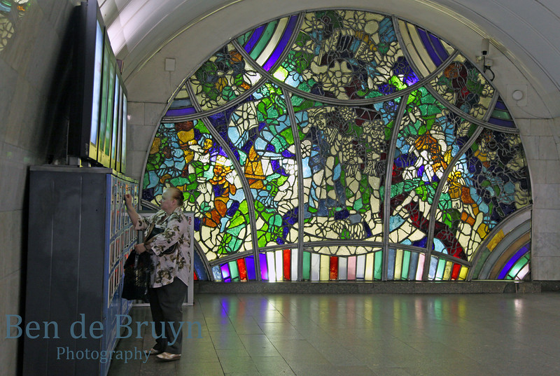 Moscow metro station with colored glass wall mural