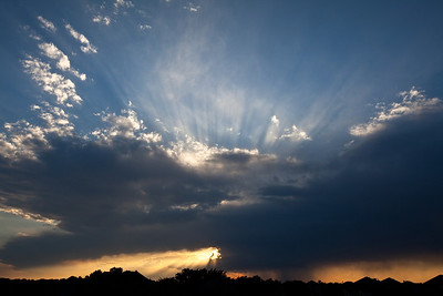 5-12-11  Frisco, Texas  Crepuscular rays emerge when a storm cloud covers the sun at sunset.