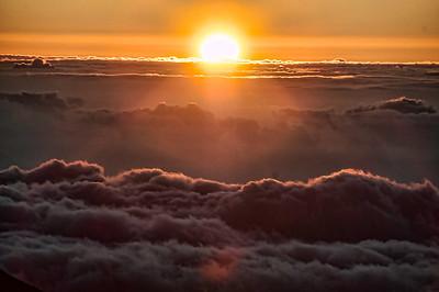 Sunrise.       The sun peaks over the crater rim at sunrise over Haleakala, Maui.
