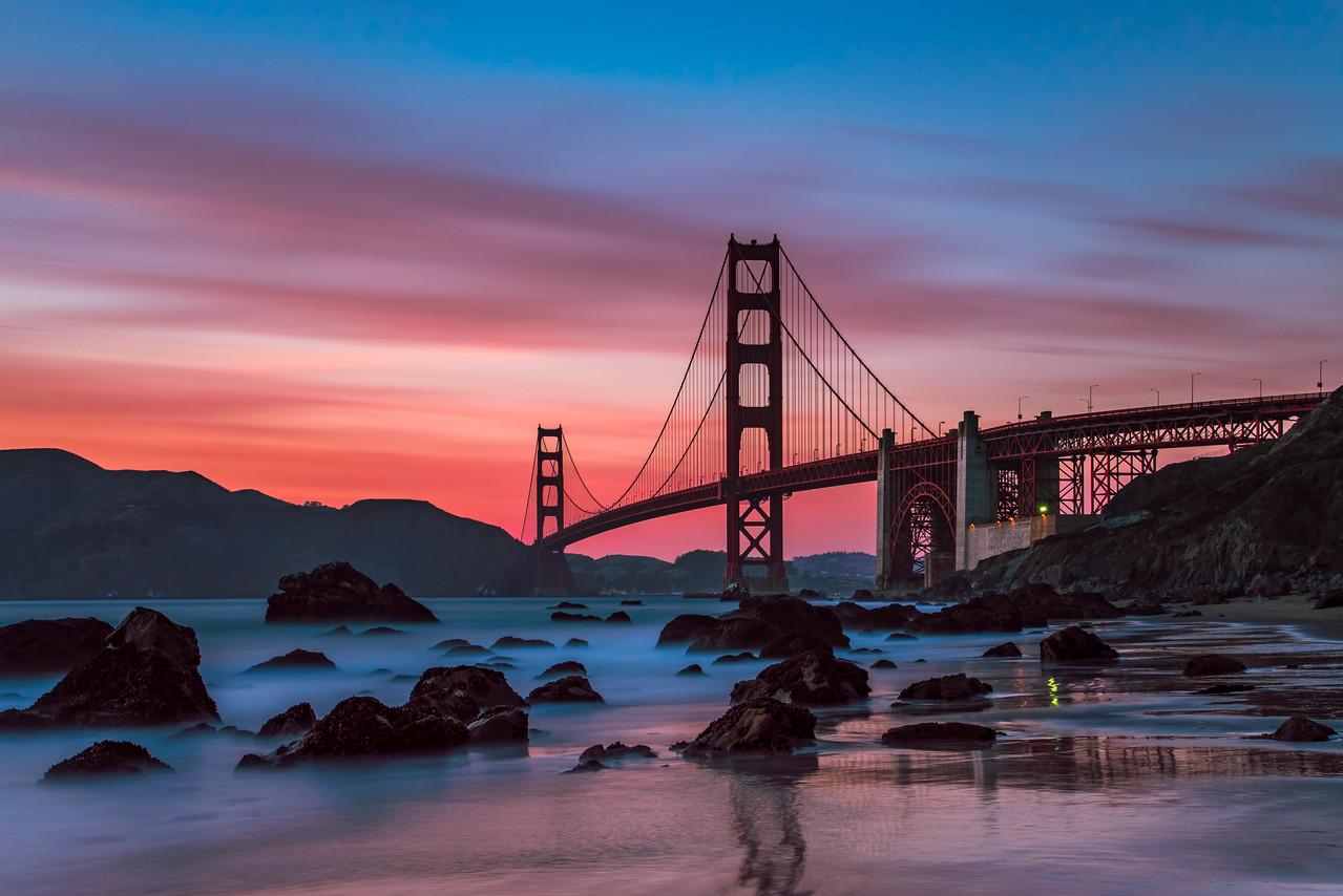 The sunset moves over the Golden Gate Bridge.