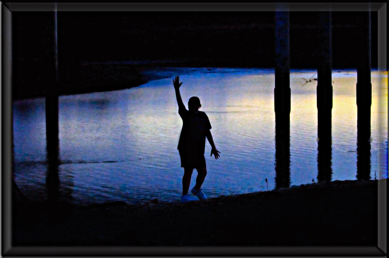 """""""SHELBY SILHOUETTE"""" <br /> I love this silhouette of my daughter even though in the beginning it was full of problems. Rather than hit the delete key I <br /> decided to take advantage of the problems using some special effects in Photoshop. Amazingly it urns out this Shelby's absolute favorite pic of all time - lol - go figure. She loves the blues and exspecailly the neon blue looking shoes which I'd considered darkening. When I suggested doing so she gasped and said mom, that's what makes it special... it's different, it's weird. Okay I can understand that. Her friends all agreed so guess I'll be looking for more weirdness to leave intack. :)"""