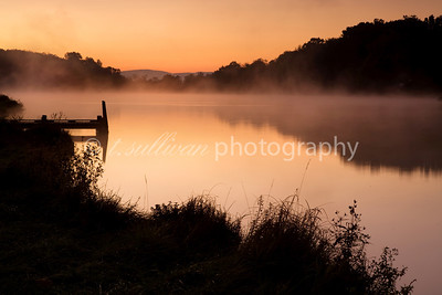 Mist rises from Lake Shenandoah during a chilly sunrise.