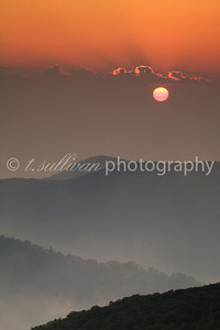A hot, humid, and hazy sunrise at Thorofare Overlook on Skyline Drive, in Shenandoah National Park.