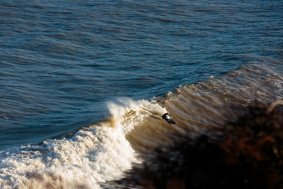Surfing on a point break into the darkness