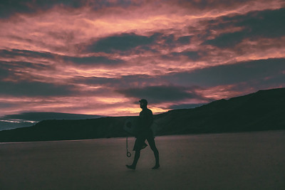 A Bodyboarder at Sunrise