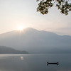 Fisher man with his boat at Sun Moon Lake in the early morning - Taiwan - Asia